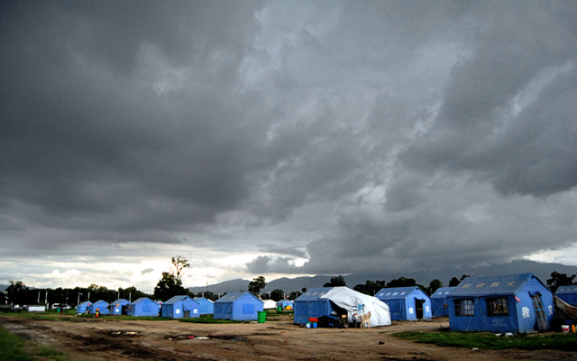 Dark grey thick clouds gathering above the makeshift tents for quake victims at Tundikhel just prior to a downpour, in Kathmandu, on Tuesday. Photo: THT