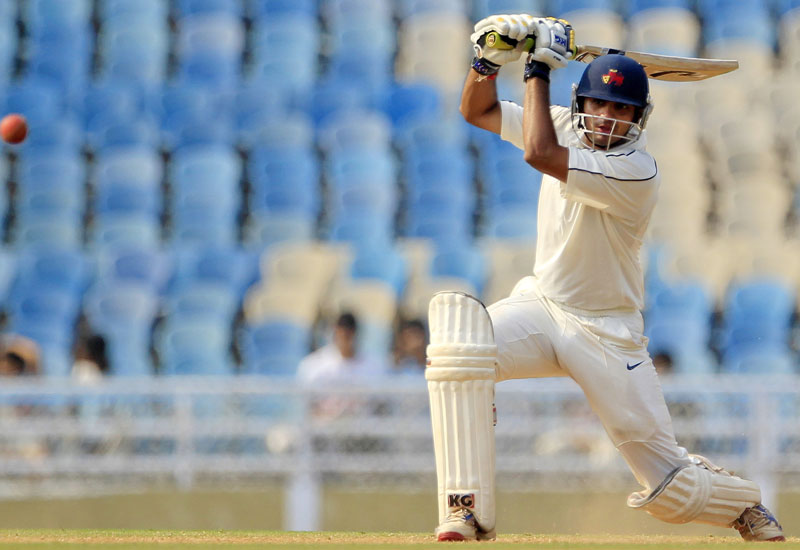 In this Sunday, Nov. 4, 2012 file photo, Mumbai A.'s batsman Hiken Shah watches his shot during the second warm-up match against England in Mumbai, India. Shah, 30, has been suspended for making a corrupt approach to an Indian Premier League player, the Board of Control for Cricket in India said on Monday. Photo: AP