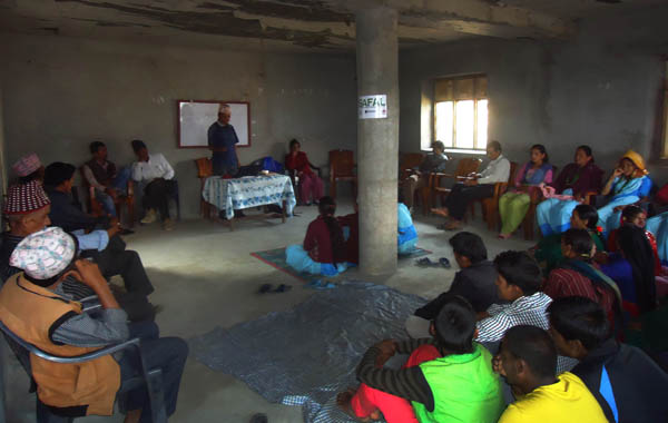 Locals, political leaders, teachers and activists discussing establishment of emergency relief fund for HIV victims at Barhabisha VDC, Bajura, on Thursday. Photo: THT