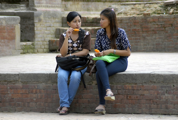 Girls having ice candy in Patan Durbar Square, Lalitpur, on Saturday. Photo: THT