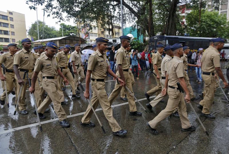Indian policemen patrolling a road near the residence of Yakub Memon, in Mumbai, on Thursday. Photo: Reuters