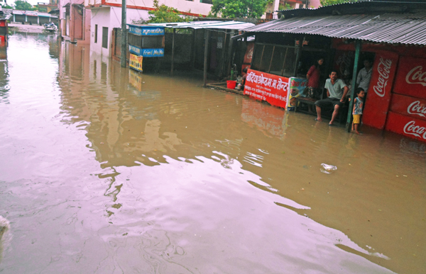 A view of New Road bazaar area, which was inundated after rainfall that lasted throughout the night, in Nepalgunj, on Thursday.   Photo:THT