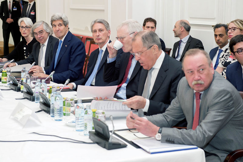 US Secretary of State John Kerry(3rd-L), flanked by Under Secretary of State for Political Affairs Wendy Sherman(L) and U.S. Energy Secretary Dr. Ernest Moniz(2nd-L), sits with British Foreign Secretary Philip Hammond(4-L) and Russian Foreign Minister Sergey Lavrov(2nd-R) on July 6, 2015, in Vienna, Austria, during a plenary session of the P5+1 member countries amid negotiations with Iranian officials about the future of their country's nuclear programme. Photo: AFP
