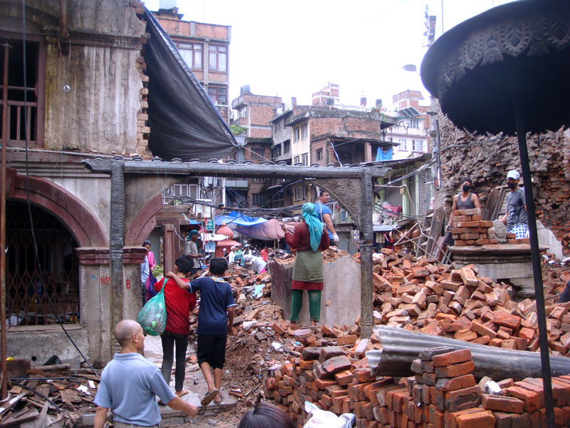 The Dya Chhen Temple (meaning, the House of God) in Janabahal of Kathmandu is being demolished as the April 25 earthquake cracked it, on Saturday, July 25, 2015. Locals are planning to reconstruct the Temple after demolition. Photo: Nasana Bajracharya/THT Online