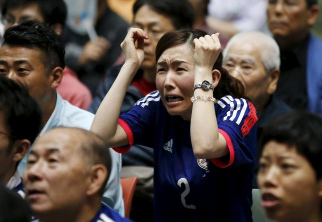 A Japan soccer fan reacts as she watches Japan's FIFA Women's World Cup final match against the U.S. in Vancouver, at a public viewing event in Tokyo, Japan, July 6, 2015.  REUTERS/Toru Hanai