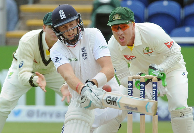 Englandu2019s Joe Root plays a shot watched by Australiau2019s wicket keeper Brad Haddin (right) during day one of their first Ashes Test, in Cardiff, Wales, on Wednesday. Photo: AP