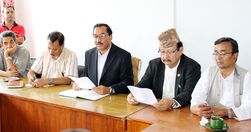 Rastriya Prajatantra Party-Nepal Chairman Kamal Thapa briefing the media about the partyu2019s decision to stay away from public feedback on draft constitution, after the meeting of the Parliamentary Party, in Kathmandu, on Monday.  Photo: RSS