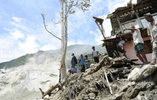 Locals outside a house hit by landslide at Jure of Sindhupalchok. Photo Courtesy: Nepal Armynn