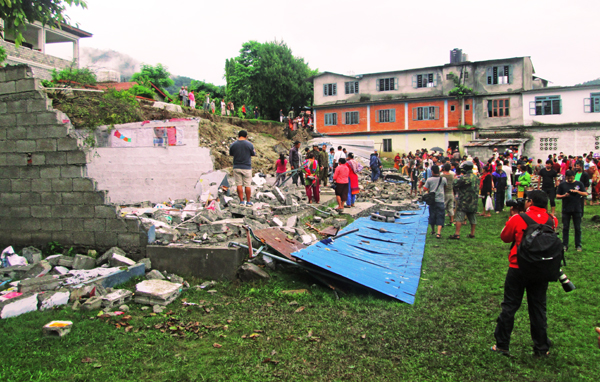 The collapsed Chhorepatan-based Ex-army Boarding School building after it was hit nby a landslide in Pokhara on Thursday.  Photo: THT