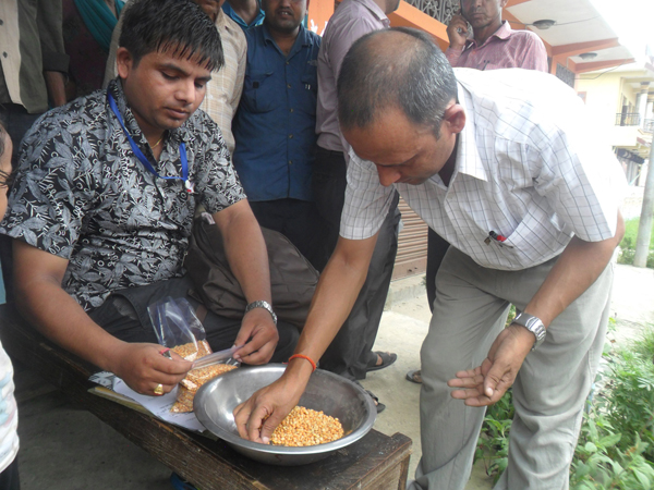 District Food Inspector Navin Deuja and other officials inspecting lentils stored in a godown, in Chitwan, on Friday. Photo: RSS