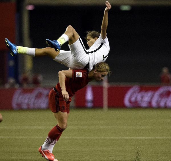 Americau0092s Tobin Heath (top) vies for the ball with Germany's Almuth Schult during their FIFA Women's World Cup semi-final match at the Olympic Stadium in Montreal on Tuesday. Photo: AFP