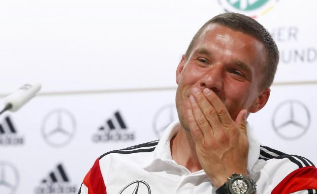 Germany's national soccer player Lukas Podolski gestures during a news conference in the village of Santo Andre north of Porto Seguro June 14, 2014.   REUTERS/Arnd Wiegmann