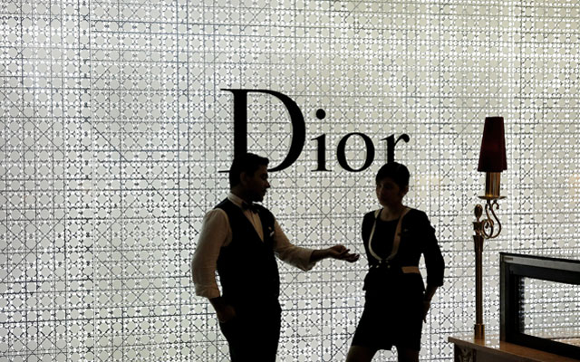 Foreign workers chatting during a quiet period at a luxury mall in Kuala Lumpur, on Tuesday. Malaysia plans to bring in 1.5 million foreign workers over the next three years to meet business demand. Photo: Reuters