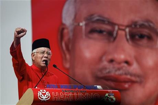 In this May 11, 2015 file photo, Malaysian Prime Minister Najib Razak addresses delegates during his speech at the Malaysia's ruling party United Malays National Organization's (UMNO) anniversary celebration in Kuala Lumpur, Malaysia. Najib is facing the risk of a criminal charge over allegations that millions of dollars were funneled from an indebted state fund to his personal bank accounts, the first time the country's leader has faced criminal allegations. The attorney general confirmed late Saturday, July 4, 2015 he has received documents from an official investigation that made the link between Najib and the investment fund 1MDB. Photo: AP