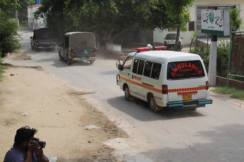 Police vehicles escort an ambulance carrying the dead bodies of Sunni militant leader Malik Ishaq and others to their hometown, in Muzaffargarh, Pakistan, Wednesday, July 29, 2015. Ishaq, one of Pakistanu00e2u0080u0099s most-feared Islamic militant leaders, believed to be behind the killing of scores of minority Shiites, was gunned down along with 13 associates during a militant assault on a police convoy that was transporting him from prison on Wednesday. Photo: AP