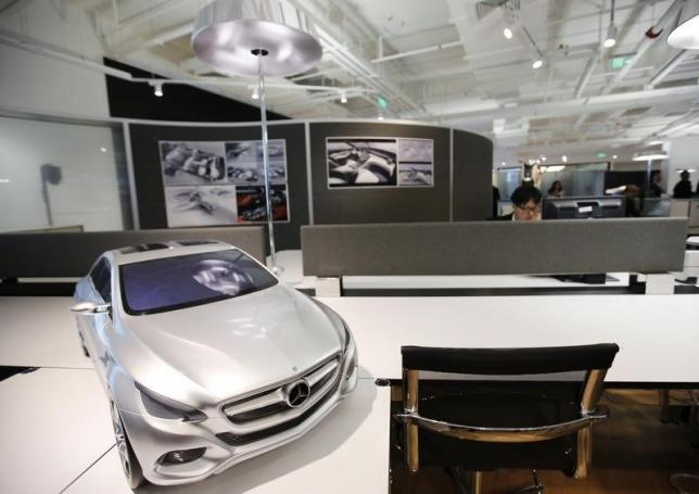 A staff works at a design centre of Daimler AG's Mercedes-Benz research and development (R&D) centre where a model of Mercedes-Benz's vehicle is displayed, in Beijing November 3, 2014. REUTERS/Kim Kyung-Hoon