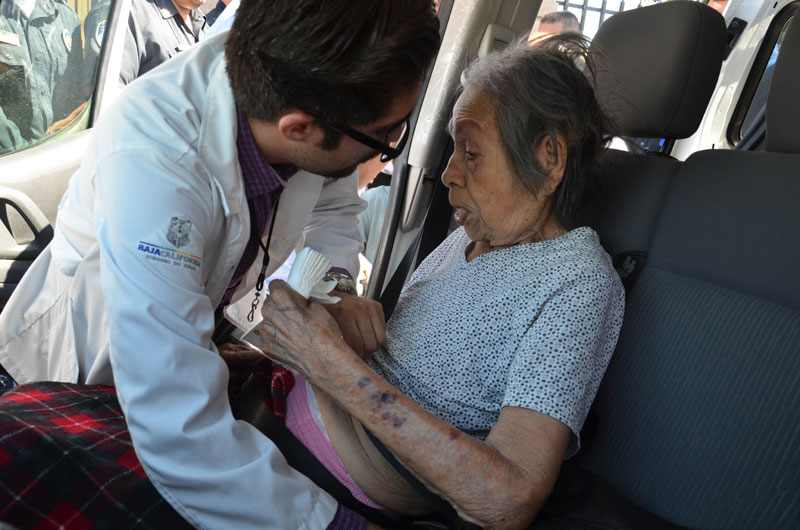 A paramedic attends an elderly woman after evacuating her from a nursing home that caught fire in Mexicali, Mexico, Tuesday, June 23, 2015. The fire killed more than a dozen elderly residents at the home, and the cause of the blaze was being investigated by the state prosecutors' office, according to Mexicali Mayor Jaime Diaz Ochoa. Photo: AP