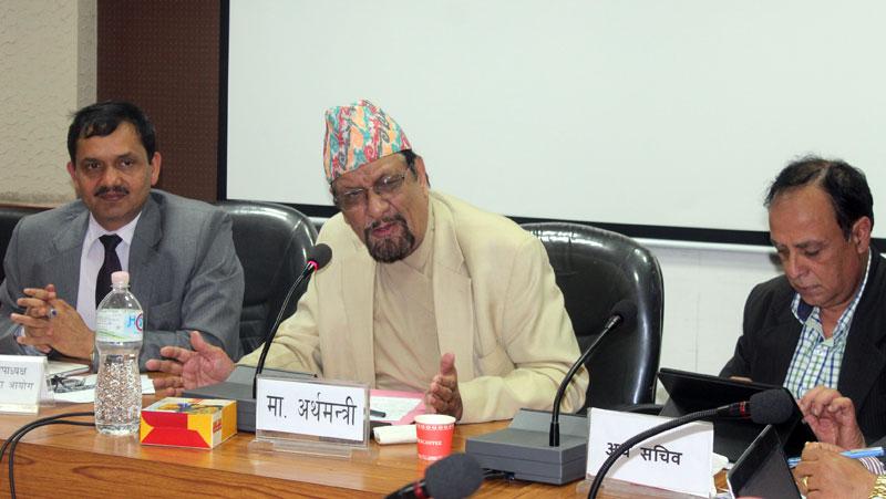 Flanked by National Planning Commission Vice-Chairman Govinda Raj Pokharel (left) and Finance Secretary Suman Prasad Sharma, Finance Minister Ram Sharan Mahat addresses a meeting of secretaries in Kathmandu, on Friday, July 31, 2015. Photo: MoF