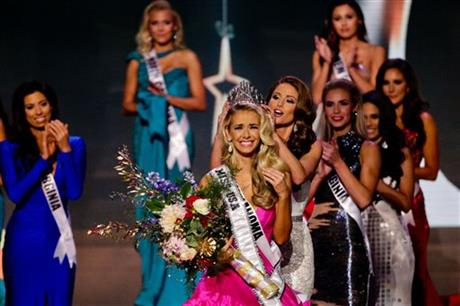 Miss Oklahoma Olivia Jordan is crowned Miss USA by Miss USA 2014 Nia Sanchez during the 2015 Miss USA pageant in Baton Rouge, La., Sunday, July 12, 2015. Photo: AP