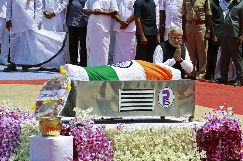 Indian Prime Minister Narendra Modi gestures after placing a wreath on the body of former President APJ Abdul Kalam, wrapped with the national flag, during the funeral ceremony in Rameswaram, on Thursday. Photo: Reuters