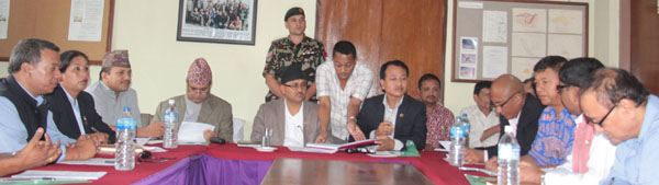 Youth and Sports Minister Purushottam Paudel (centre) and officials attend the 102nd Board Meeting of National Sports Council in Kathmandu on Friday. Photo: THT