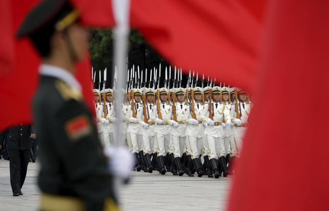China's People Liberation Army (Navy) sailors from the honour guard march during a welcoming ceremony for Fiji's Prime Minister Josaia Voreqe Bainimarama outside the Great Hall of the People, in Beijing, July 16, 2015. Photo: Reuters