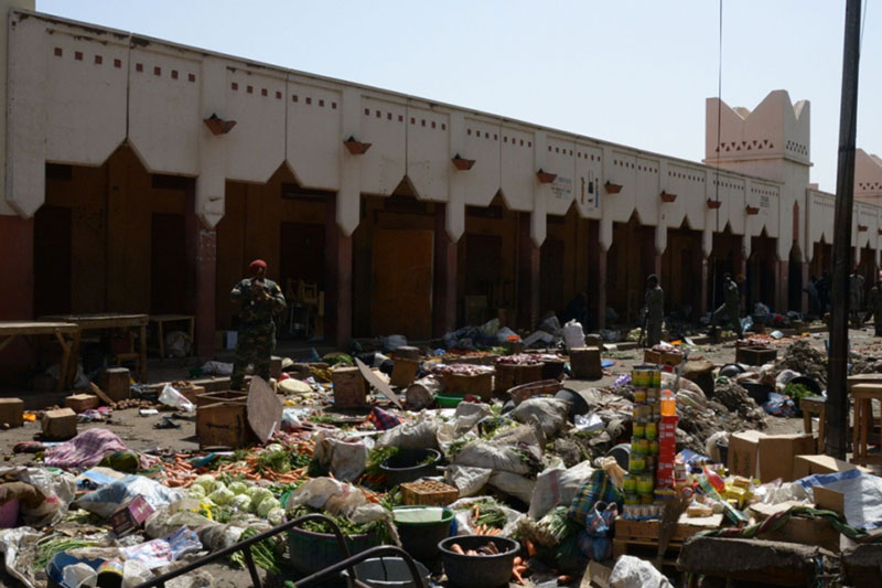 A soldier stands guard at a market in N'Djamena following a suicide bomb attack on July 11, 2015. At least 14 people were killed in a suicide bomb attack at a crowded market in Chad's capital today just days after Boko Haram claimed a previous bombing in the city that left 38 people dead. The attack in N'Djamena by a man disguised as a woman in a full-face veil came after a botched bombing of a bus station in the restive capital of Nigeria's Borno state, Maiduguri, which killed two pedestrians. Photo: AFP
