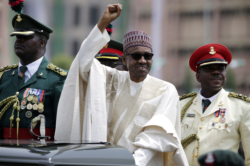 In this May 29, 2015 file photo, Nigerian President, Muhammadu Buhari, salutes his supporters during his Inauguration in Abuja, Nigeria. Photo: AP