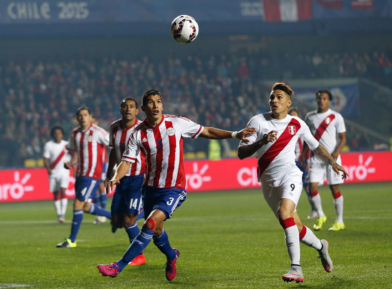 Paraguay's Marcos Caceres (left) goes for the ball with Peru's Jose Paolo Guerrero during their third place match of the Copa America at the Ester Roa Rebolledo Stadium on Friday. Photo; AP