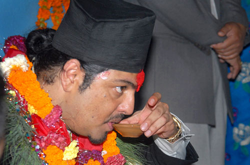 Former crown prince Paras Shah sipping a home-brewed liquor during a programme organised by Khadgi Samaj Sewa, in Kathmandu on Saturday, August 21, 2010. THT file photo.