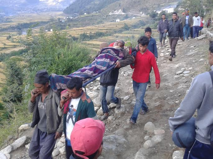 A patient being taken to the district headquarters Martadi for treatment in Bajura on Sunday, July 12, 2015.Prakash Singh