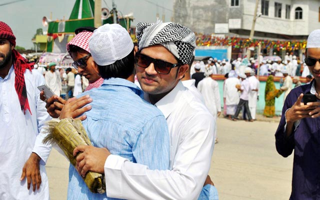 Two youths exchanging Eid greetings at a mosque, in Birgunj, in July 2015. Photo: THT