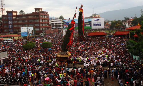 People taking part in the Rato Machhindranath Festival while the chariot is pulled from Lagankhel to Jawalakhelu201a in Lalitpur in June 2014. The monthlong festival will conclude with the Bhoto Jatra. Photo: Xinhua/Filen