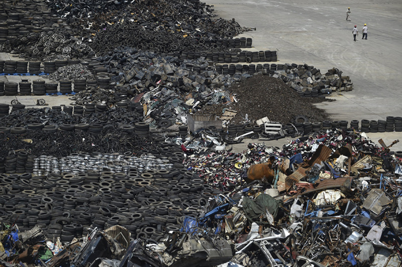 Scrap parts of vehicles are seen at an automobile recycling factory of GEM Co, Ltd, in Wuhan, Hubei province, on Thursaday. Growth in China's manufacturing sector likely steadied in July but remained at a subdued pace, a Reuters poll showed. Photo: Reuters