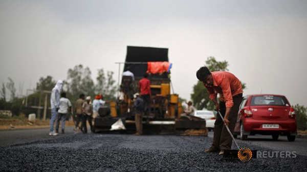 A file photo of labourer working at the construction site of Delhi-Jaipur national highway in Manesar, Haryana. Photo: Reuters