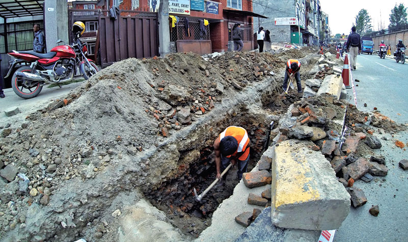 Workers dig a road in Anamnagar of the Capital to establish pipelines for the Melamchi Water Supply Project. Photo: THT/File.