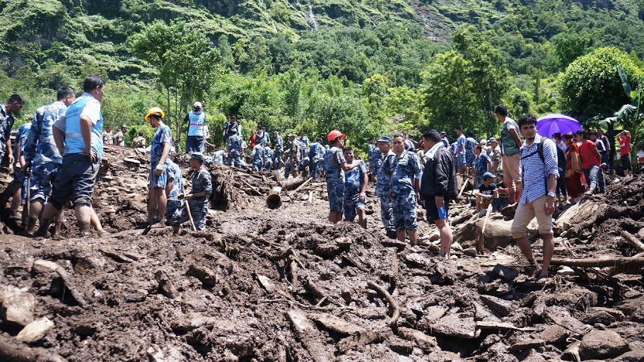 Police personnel searching for the bodies buried by massive landslides in Kaski on Thursday, July 30, 2015. Photo: Bharat Koirala