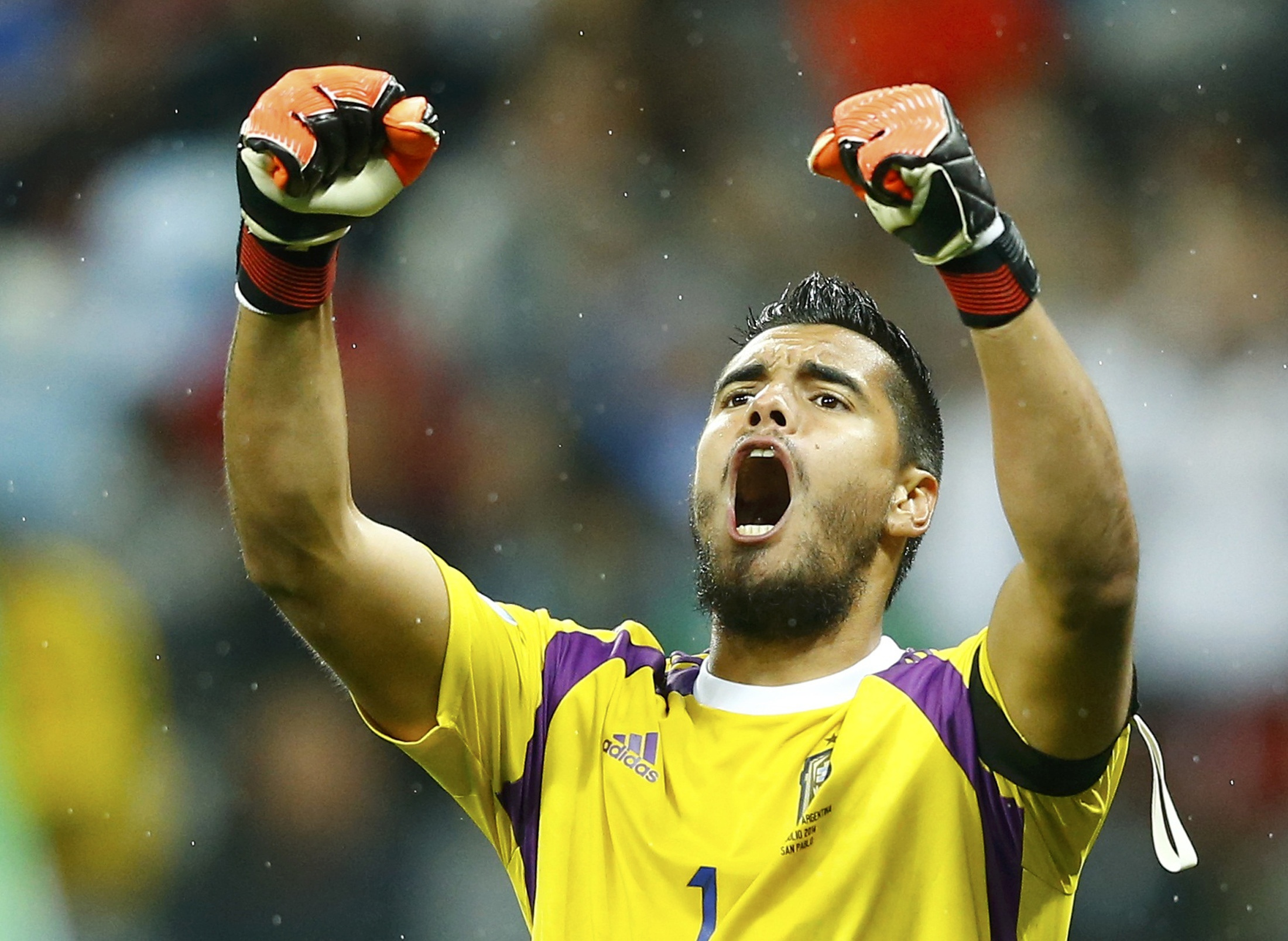 Argentina's goalkeeper Sergio Romero celebrates after saving the ball for the second time during a penalty shoot-out at their 2014 World Cup semi-finals against the Netherlands at the Corinthians arena in Sao Paulo July 9, 2014.   Photo: Reuters