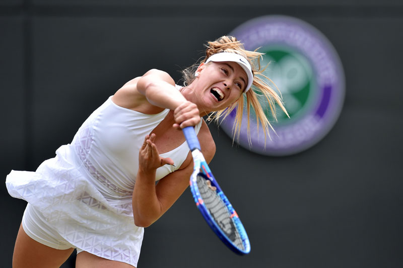 Russia's Maria Sharapova serves against Kazakhstan's Zarina Diyas during their women's singles fourth round match of the 2015 Wimbledon Championships at the All England Tennis Club in London on Monday. Photo: AFP
