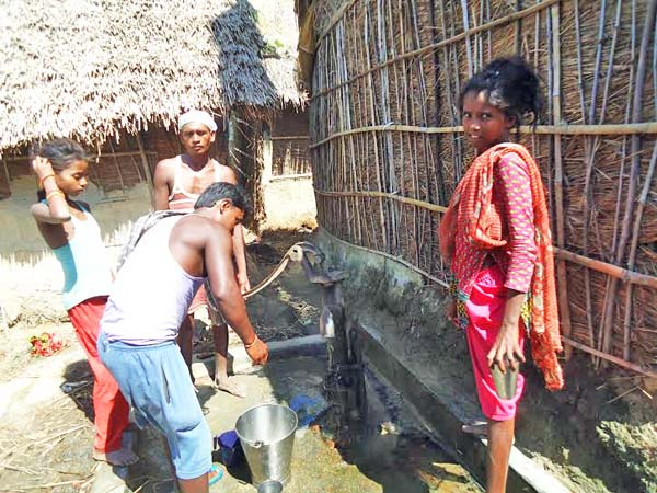 Musahar People fetching water from the tube well that they have in their community in Kodarkatti of Ramnagar VDC-3 in Saptari on Monday, July 27, 2015. Photo: Byas Shankar Upadhyaya