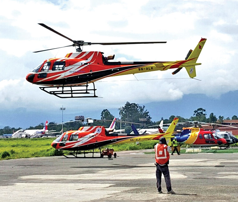A photo provided by Shree Airlines shows its new French Airbus manufactured AS350 B3e chopper, at Tribhuvan International Airport, Kathmandu.