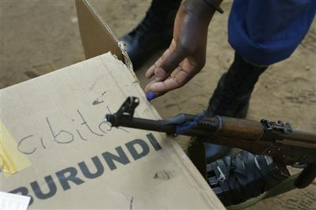 A soldier tries to erase the ink on his finger after he cast his vote in the presidential elections in Bujumbura, Burundi, Tuesday July 21, 2015. AP