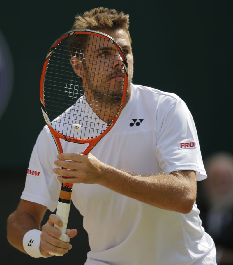 In this July 2, 2014, file photo, Stan Wawrinka of Switzerland prepares to play a return to compatriot Roger Federer during their men's singles quarterfinal match at the All England Lawn Tennis Championships at Wimbledon in London. Photo: AP