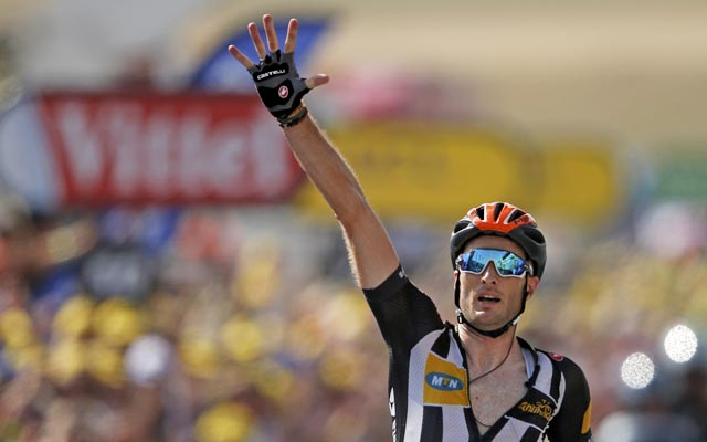 Stephen Cummings celebrates as he crosses the finish line to win the 14th stage of the 102nd Tour de France in Mende on Saturday. Photo: Reuters