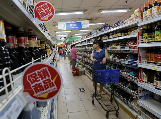 A woman shops for groceries at a supermarket in Beijing, China, July 9, 2015. REUTERS/Kim Kyung-Hoon