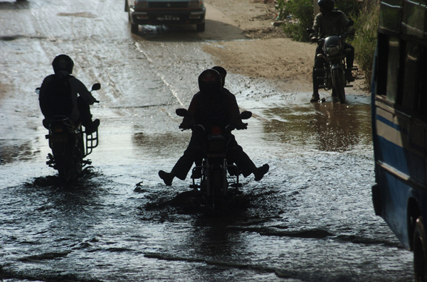 Motorcyclists crossing a waterlogged road, in Thapathali, Kathmandu, on Thursday. Poor drainage system often leads to flooding of roads in many parts of the capital city during monsoon.nPhoto: Dhurba Ale/THT