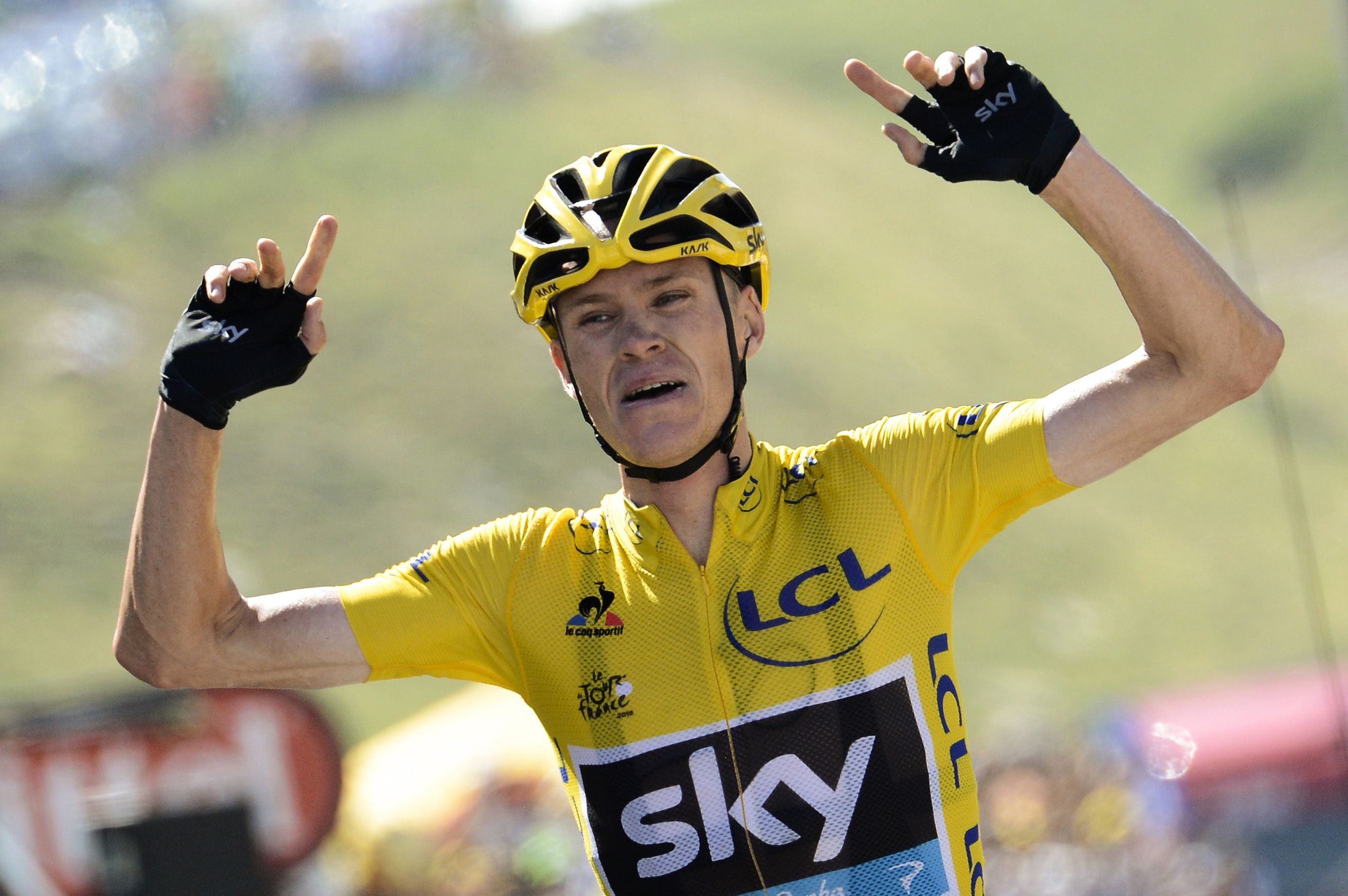 Great Britain's Christopher Froome celebrates as he crosses the finish line at the end of the 167 km tenth stage of the 102nd edition of the Tour de France cycling race on July 14, 2015, between Tarbes and La Pierre-Saint-Martin, southwestern France.  Photo: AFP