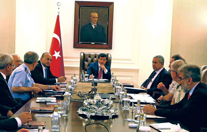 Turkey's Prime Minister Ahmet Davutoglu chairing a security meeting in Ankara, on Saturday. Photo: Reuters