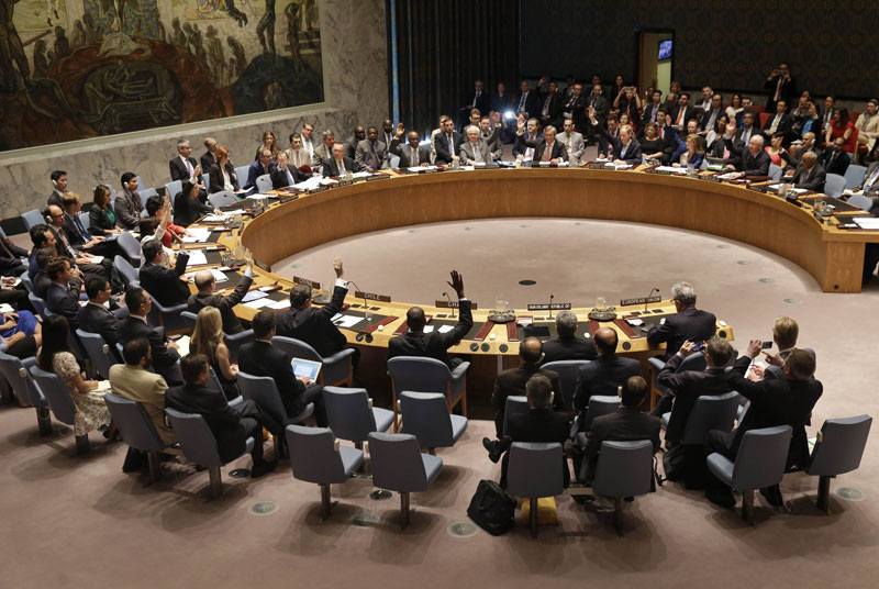 Members of the Security Council vote at United Nations headquarters, Monday, July 20, 2015. The U.N. Security Council unanimously endorsed the landmark nuclear deal between Iran and six world powers and adopted a series of measures leading to the end of U.N. sanctions that have hurt the Iranian economy. Photo: AP