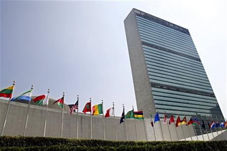 File - The flags of member nations fly outside the General Assembly building at the United Nations headquarters in New York, on September 13, 2005. Photo: AP